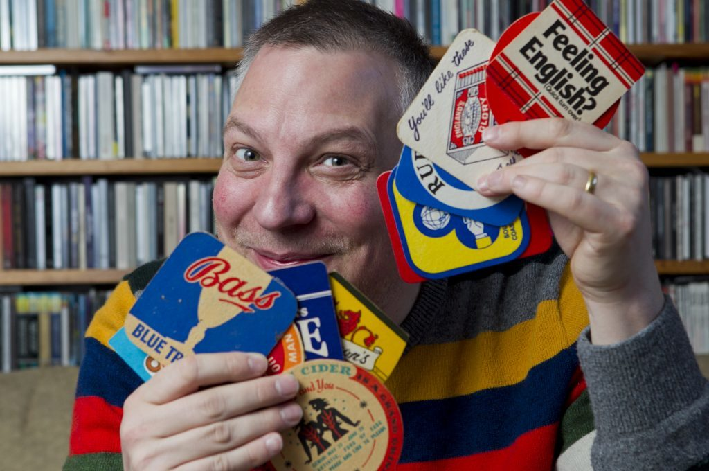 Dundee man Jan Burnett -  record, beer mat, and gig poster collector -  at his home in Glasgow