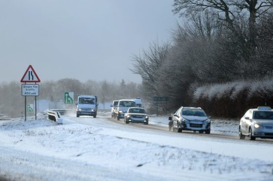 Traffic negotiating difficult conditions on the A92 at Balfarg following recent snowfall.