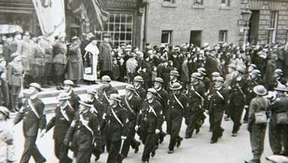 Polish soldiers march down Bonnygate, Cupar, in 1942