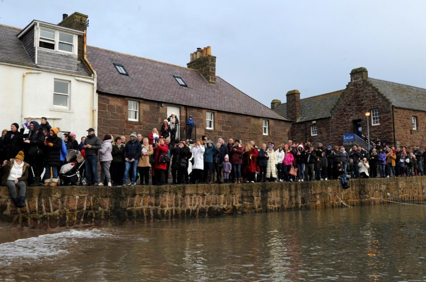 Crowds line up to watch Stonehaven's dook. Pic: Kenny Elrick.