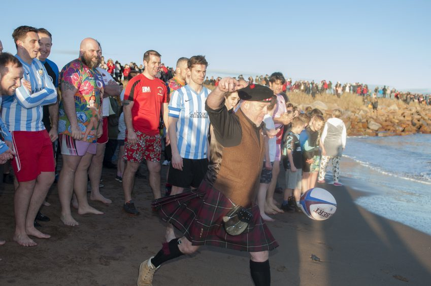 Carnoustie's New Year Dook. Rob Bruce, President of the rugby club kicks off the event.