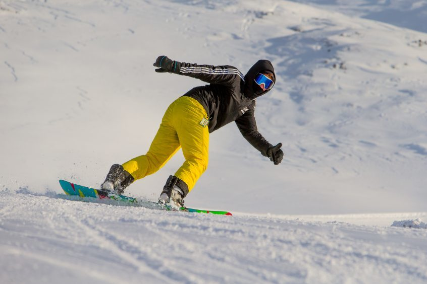 A snowboarder on the slopes