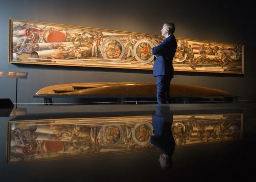 Philip Long viewing one of the Ocean Liners: Speed and Style exhibits in London.