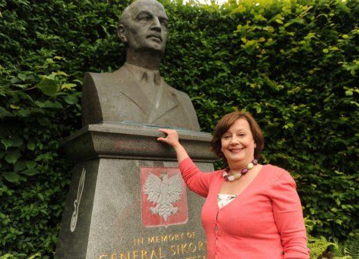 Violeta Ilendo, chairwoman of the Fife Migrants Forum, at the General Sikorski statue in Kinburn Park, St Andrews