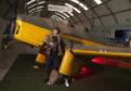 Museum curator Dan Paton recreates a Winkle Brown pose.