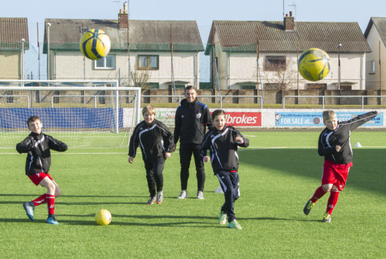 Montrose FC development officer Adam McWilliam coaching youngsters at Links Park.