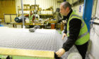 A technician cuts fabric at Sekers Fabrics workshop at Wester Gourdie Industrial Estate, Dundee.