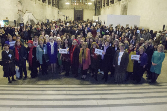 Prime Minister Theresa May (fifth from left) poses with female parliamentarians past and present to celebrate the Centenary of the Representation of the People Act, 1918.