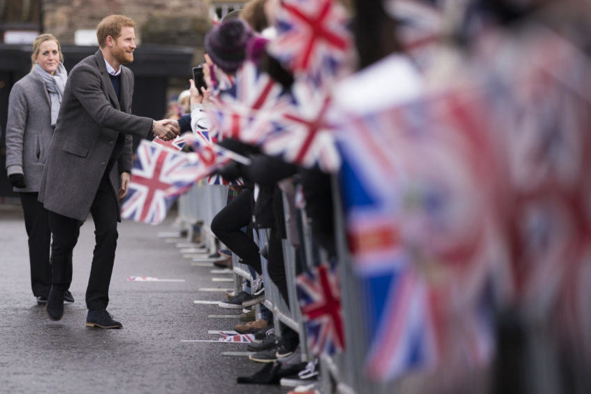 Prince Harry meets well wishers during a walkabout on the esplanade at Edinburgh Castle