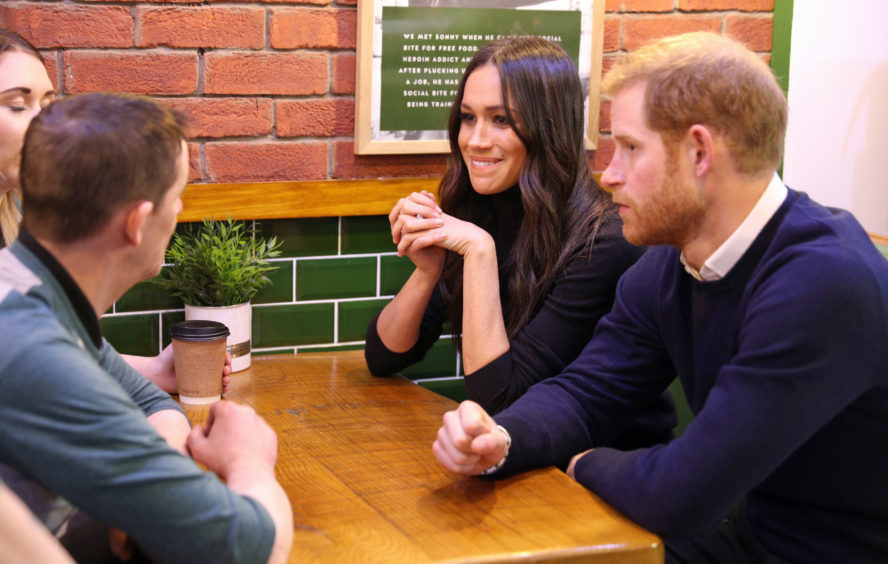 Prince Harry and Meghan Markle during their visit Social Bite