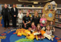 Young readers joined Arbroath FC, Forfar FC and Angus Council representatives, and Loons mascot Baxter the Bridie at the Forfar library 4-4-2 launch.