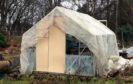 A greenhouse damaged in the latest bout of vandalism.