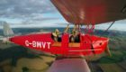 James Crawford in a 1945 Tiger Moth biplane, flying over the Strathearn Valley.