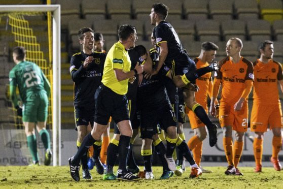 The Livi players celebrate their opening goal.