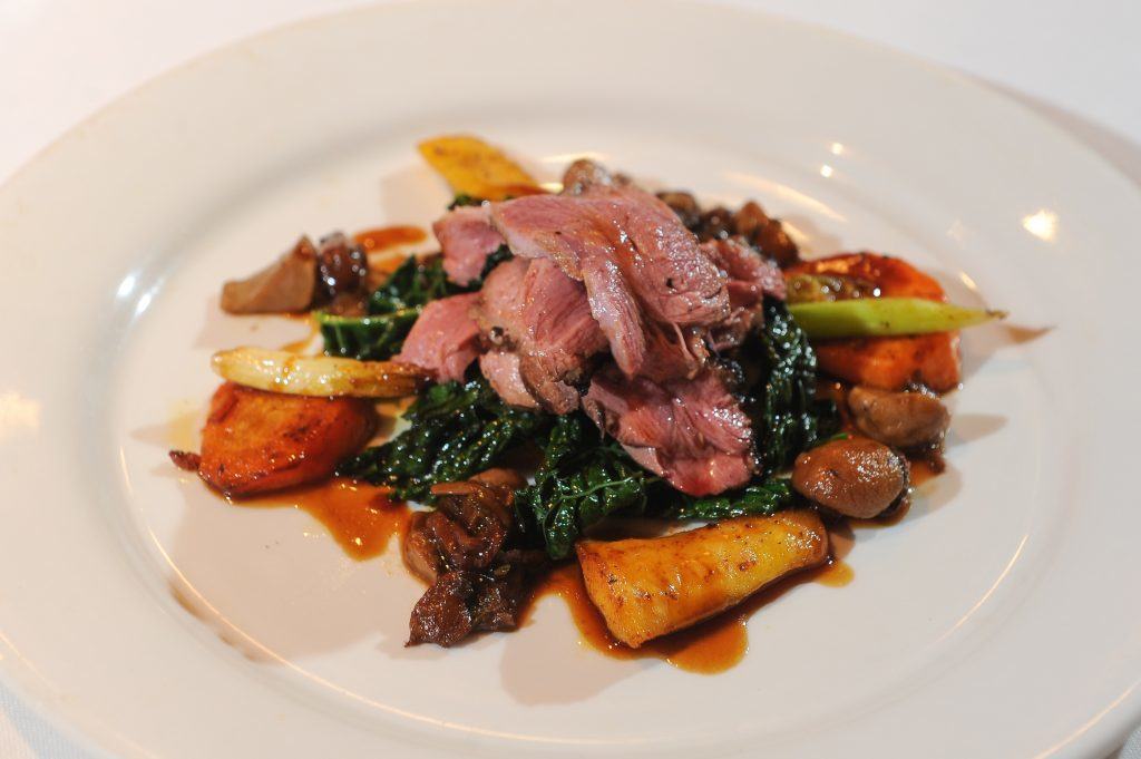Main course - Roast Breat of Duck with Cavolo Nero Kale and Wild Mushroom Sauce.