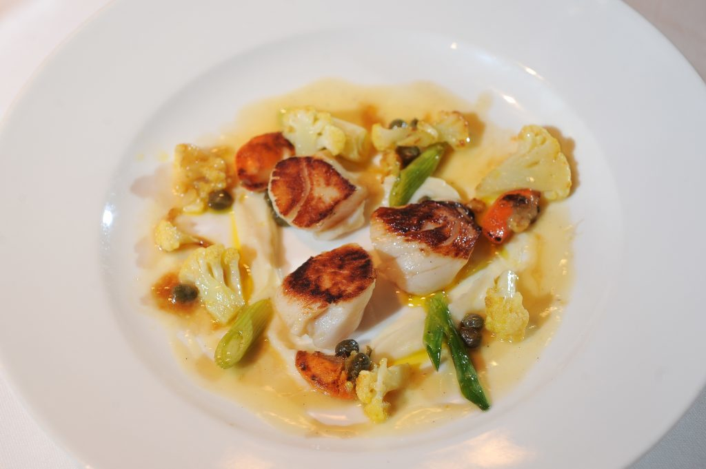 Starter - Seared Hand-dived Scallops with Roast Cauliflower, Spring Onions and Baby Capers.