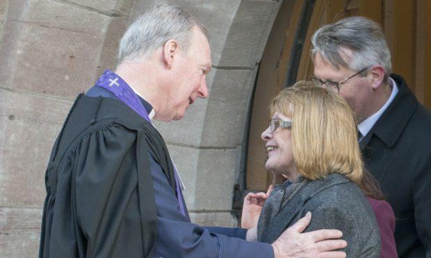 The Rev John Murdoch consoles Mr Campbell's wife Pam.