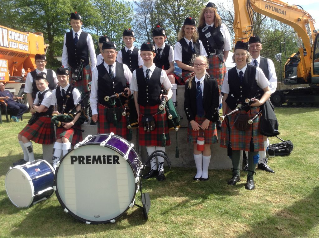 Douglas with members of the Cupar Pipe Band