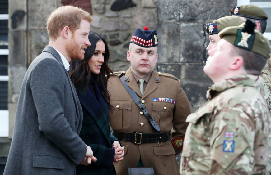 Prince Harry and Meghan Markle meet the gunners before the firing of the One O'Clock Gun at Edinburgh Castle