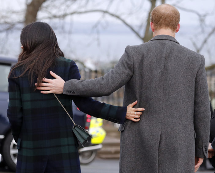 Britain's Prince Harry and his fiancee Meghan Markle arrive at Edinburgh Castle
