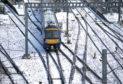 A ScotRail train leaves Edinburgh's Waverley Station.