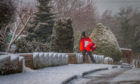 A postman braves the recent cold snap in  Castleton Road, Auchterarder.