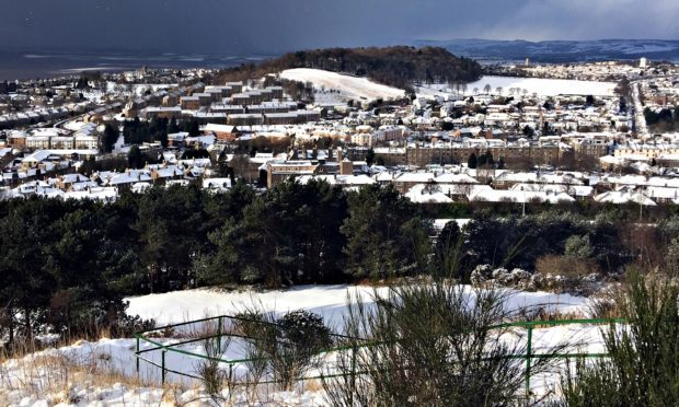 Snowy scenes across the west of Dundee, viewed from the top of The Law.