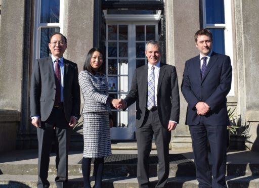 On the front steps of Craigclowan, left to right, Pan Xinchun, Consul General; Guifang Lou, Chair of LUKEC; Bill Farrar, chair of the board of governors of Craigclowan School and headmaster John Gilmour.