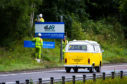 Signs for the A9 dualling project being put up north of Perth.