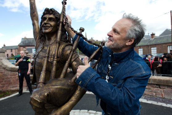 Former AC/DC bassist Mark Evans at the Bon Scott statue in Kirriemuir two years ago.