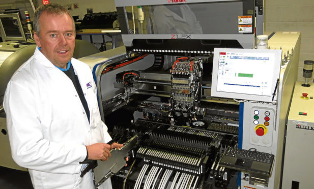 Key-Tech director Jim Spence with some of the Kirkcaldy firms cutting edge equipment.