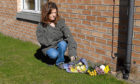 Tracey Braithwaite, who found Sonya Todd's body, lays flowers at the scene a decade ago.