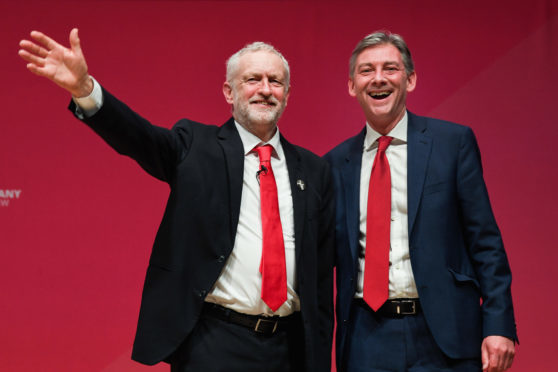 Labour UK leader Jeremy Corbyn with Scottish leader Richard at the Caird Hall in Dundee at the 2018 conference.