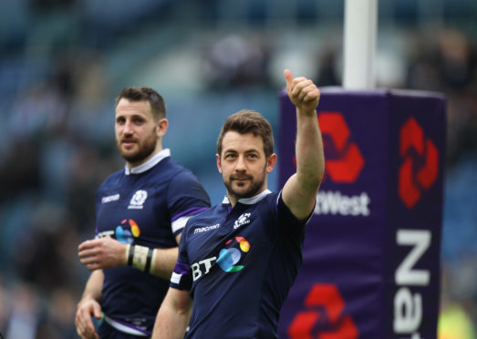 Greig Laidlaw celebrates victory after his late penalty won Scotland the game in Rome.