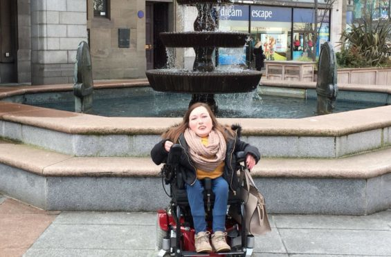 Clair D'All, Dundee ambassador for Euan's Guide, out and about in Dundee city centre.