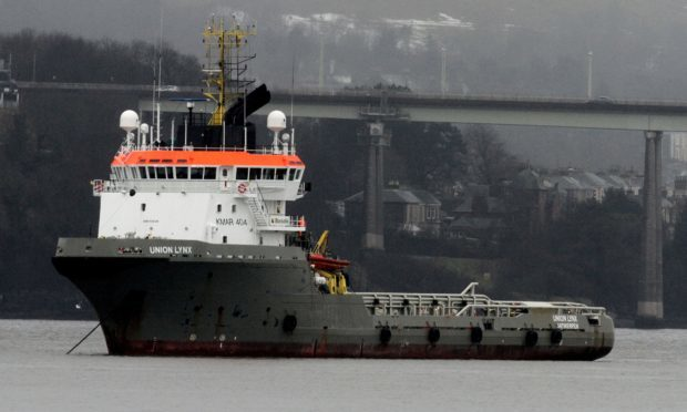 Tug boat at anchor in River Tay to free up space at bustling
