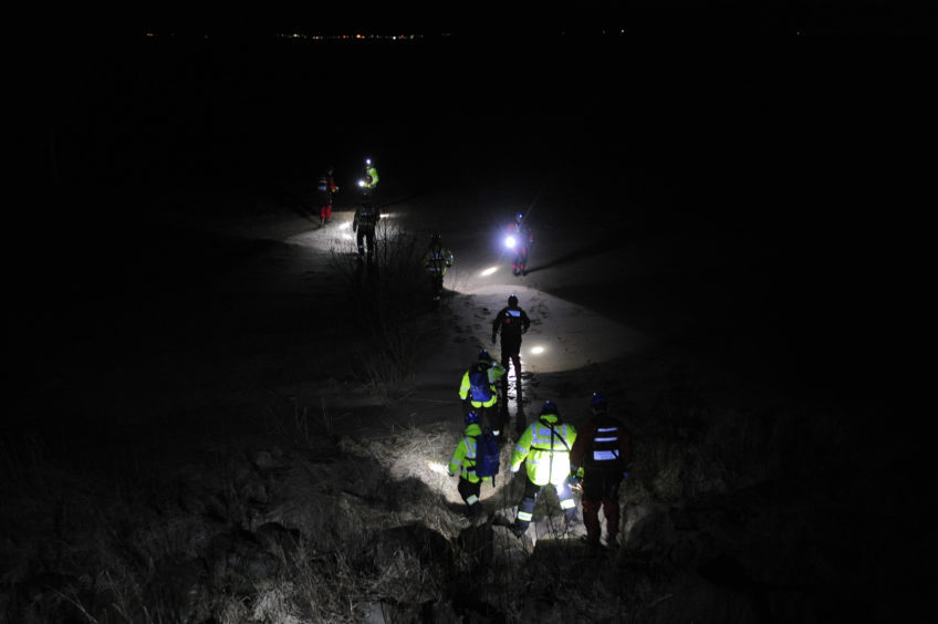 Rescuers arrive on the beach on Wednesday evening