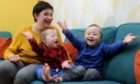 Elaine, Cameron and Ollie at home in Dundee.