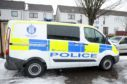 Police outside the property in Alyth in March.