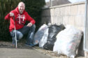 David Patterson with some of the litter he collected over three short trips.