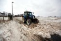 Farmers were forced to help clear the snow earlier this year - and one Fife councillor is predicting chaos this winter.