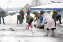 Volunteers clearing paths and a car park in Birkhill last week. But did everyone show such grit in the face of the severe weather?