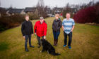 Some Longforgan residents who voiced their concerns about plans for a house on a recreation site: left to right is Councillor Alasdair Bailey alongside concerned residents Jim Gethins, his dog Corrie, Joanna McCormick and Doug Smith on the site. Mary Findlay Drive,