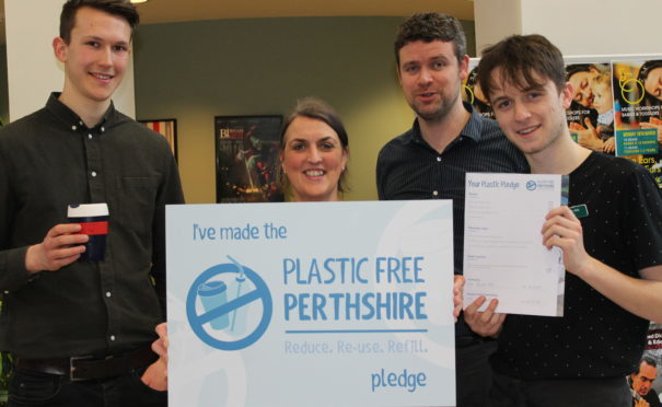 Jamie Wylie (left) and James Irvine (second from right) with staff from the Birnam Arts Centre.