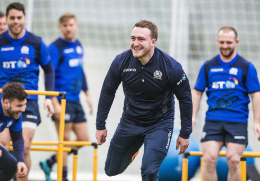Stuart Hogg enjoys Scotland's penultimate training run at Oriam ahead of the final 6 N Nations game in Rome.