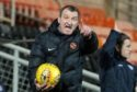 Csaba Laszlo shouts orders during the game.