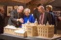 Mary, Dowager Countess of Strathmore inspeting the Streatlam Castle model with (left) Jonathan Peacock (Bowes Museum of Co. Durham) and (right) Martin Saville (builder of the model).