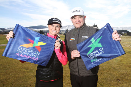 Carly Booth and fellow ambassador, Paul Lawrie.