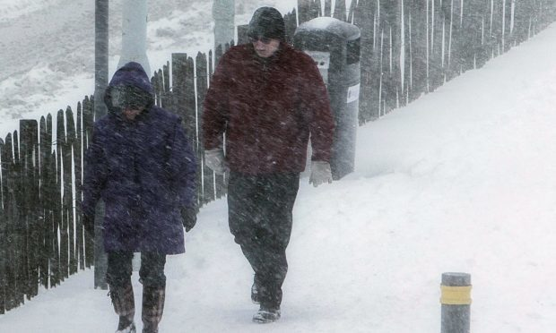 People trudge through the blizzard condition to try to get some necessary shopping in from the Kingdom Centre in Glenrothes.