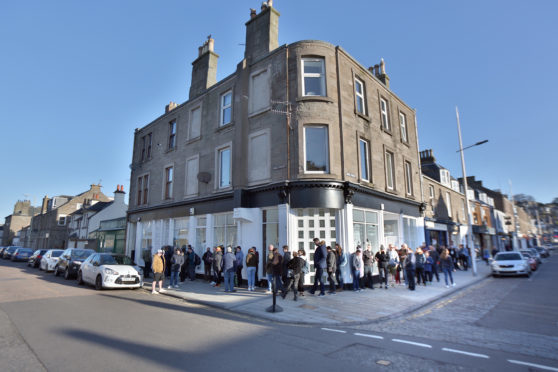 Crowds lined up outside Assai records in Broughty Ferry.